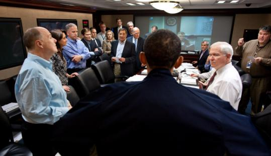 An official photo recorded President Obama speaking with advisers Sunday in the White House's Situation Room.