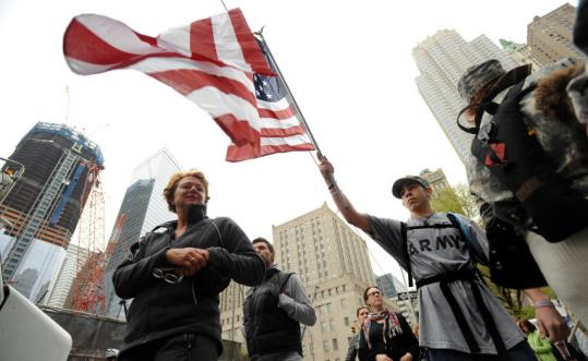 Robert Hackney, 15, a resident of upstate New York, held a flag near ground zero in Lower Manhattan yesterday.