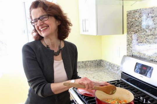 """Whole grains have really been on my table since I was born,'' says Maria Speck, cooking in her Cambridge kitchen."