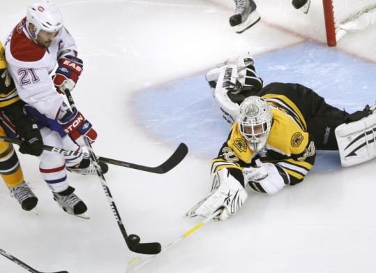 Tim Thomas (top) knocked the puck away from Brian Gionta in overtime of Game 7 against Montreal, and the Bruins goaltender denied Kris Versteeg and the Flyers in OT Monday.