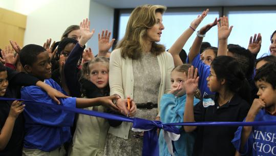 Caroline Kennedy, with students from the Winship School in Brighton, cut the ribbon to open the new 30,000-square-foot wing.