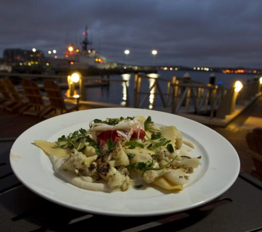 The new Aragosta Bar + Bistro's deck is a perfect spot to nosh on a plate of lobster ravioli.