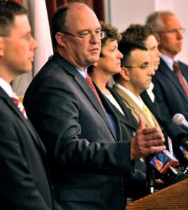 District Attorney David Sullivan was flanked by members of his office while addressing media.
