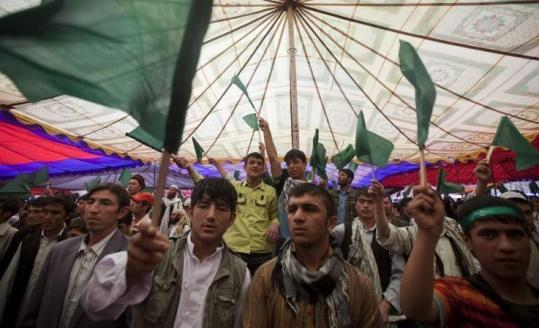 Supporters of Afghanistan's former intelligence director, Amrullah Saleh, waved green flags during a gathering in Kabul yesterday. Those at the gathering urged Afghans to reject a plan by President