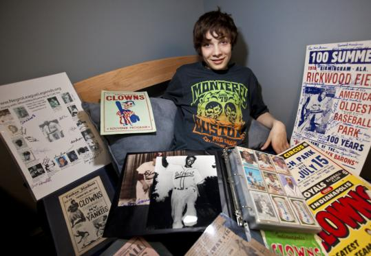 Cam Perron sat with a large portion of his Negro league baseball memorabilia collection at his home.