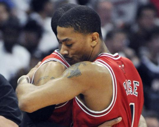 Derrick Rose, hugging teammate C.J. Watson at the end of the Bulls' win, put on an MVP-worthy show against the Hawks.