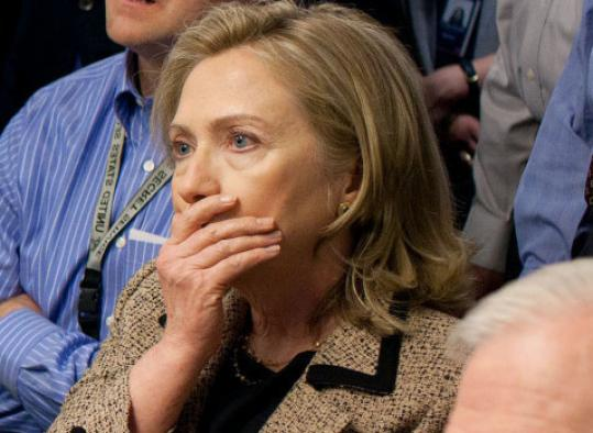 Hillary Clinton, at the White House, reacts to unfolding events in Pakistan.