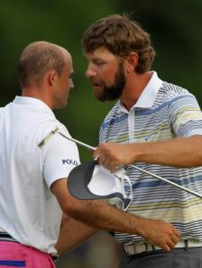 Lucas Glover (right) gives a hug to former Clemson teammate Jonathan Byrd after beating him on the first extra hole.