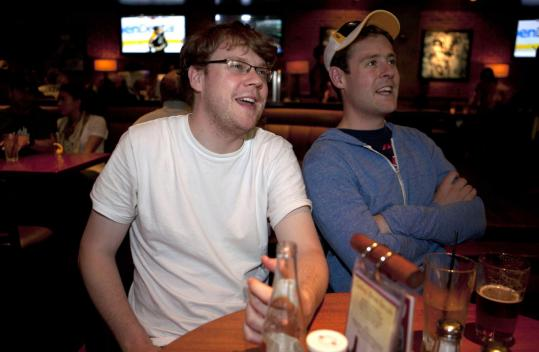 "Bandwagon fans are ""lame,'' says Bruins diehard Patrick Garvey (left, with brother Kyle) watching the B's play last week at Jerry Remy's Sports Bar & Grill."