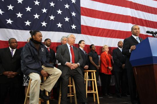 Roy Martin (front left), P.A.C.T. program manager with the Boston Public Health Commission, and Mayor Thomas M. Menino (center) listened as Governor Deval Patrick outlined his plans to combat youth violence in Massachusetts.