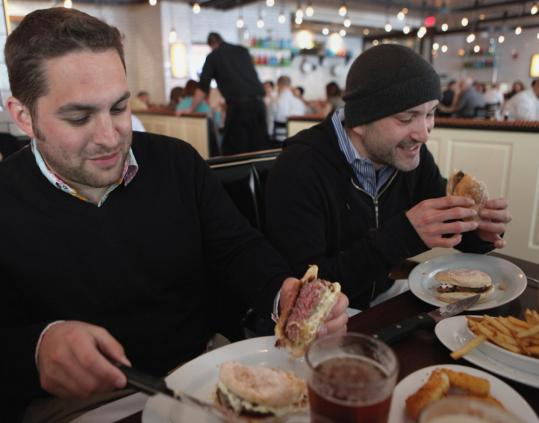 Justin Gewandter and Michael Forgash dig in at 5 Napkin Burger.