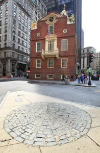 The cobblestone Boston Massacre memorial inhabits a small traffic island across from the Old State House. The removed stones will be stored by the National Park Service in Charlestown while upgrades to the MBTA's State Street subway station are underway.
