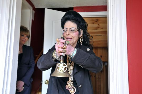 With real estate agent Janet Howcroft looking on, Salem witch Lori Bruno performs a ceremonto to cleanse any negative forces from a Peabody home.