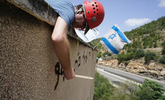 An Israeli artist repainted historic graffiti last week on the building where it was originally written in 1948.