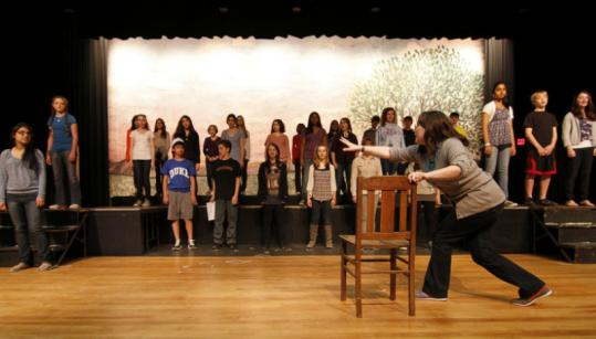 """Esme Sammons, drama director at Sharon Middle School, works with actors in """"The Halls.''"""