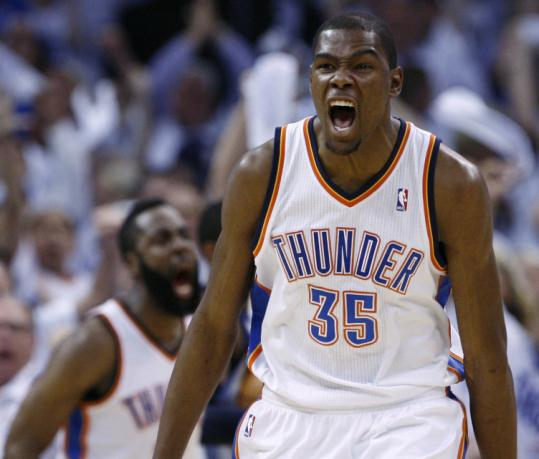 Kevin Durant howls after a thunderous dunk by Oklahoma City teammate James Harden in the second quarter.