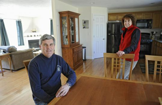 Keith and Karen Percival went from a large house in Topsfield to this smaller home in Groveland.