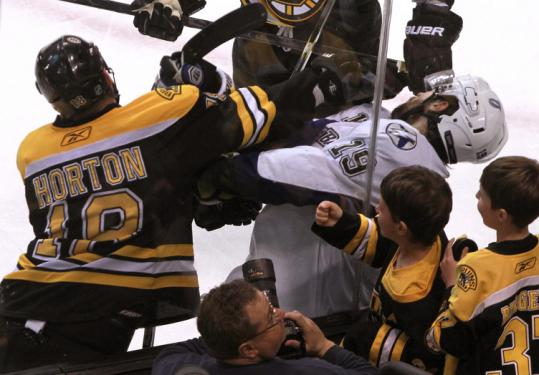 Nathan Horton comes up high on the Lightning's Dominic Moore during a third-period scrum along the boards.
