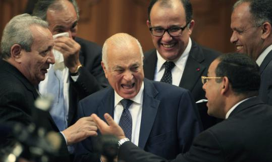 Nabil Elaraby of Egypt (center) was chosen as head of the Arab League yesterday after he replaced a divisive candidate.