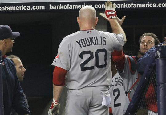 Kevin Youkilis earned praise for hitting a three-run homer in the fourth that tied the game at 4.