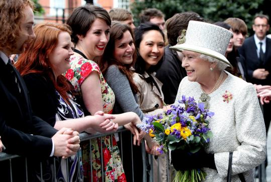 Queen Elizabeth II greeted students and staff at Trinity College yesterday at the start of a historic visit to Ireland.