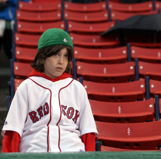 Red Sox fan Brooks Fletcher, 9, came all the way from Lake Placid, N.Y., only to be disappointed with a rainout yesterday.