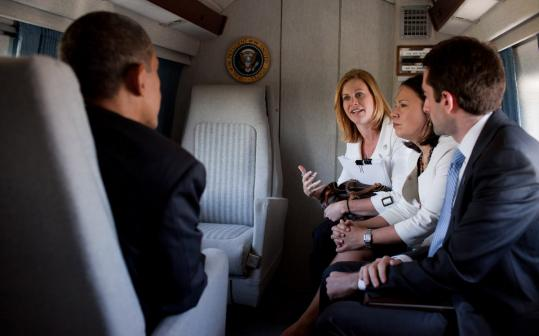 Stephanie Cutter (center), pictured aboard Marine One, has worked in the upper echelons of Democratic politics for two decades.