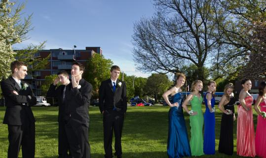 Arlington High students wait to board buses to their junior prom.