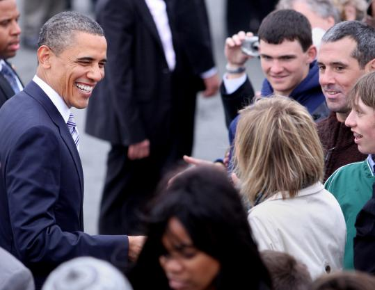 President Obama greeted well-wishers after he arrived at Logan International Airport yesterday.