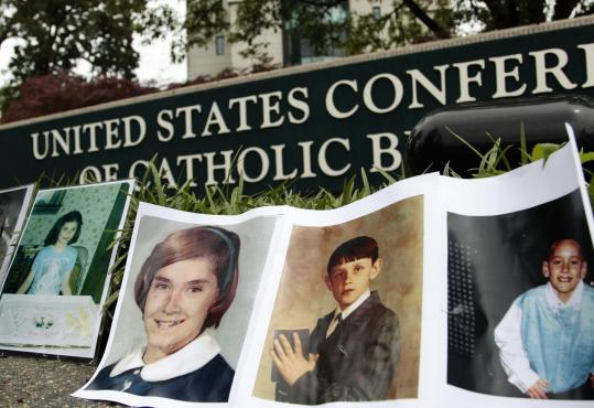 Photographs of children abused by members of the Catholic clergy were displayed during a protest near the headquarters of the US Conference of Catholic Bishops in Washington.