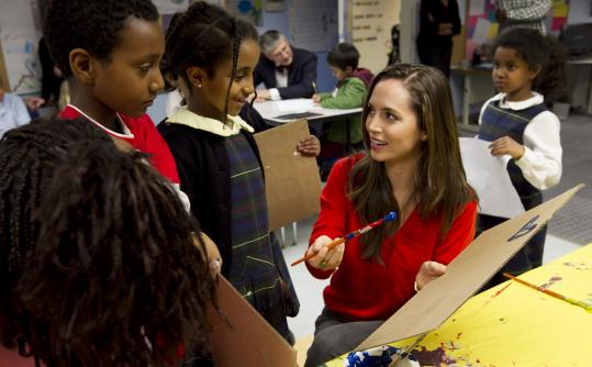 Eliza Dushku painted autographs for kids at the United South End Settlements House. While she was there, she presented a check for Camp Hale.