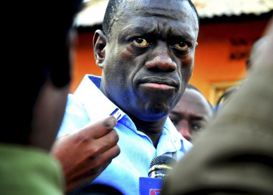 "Kizza Besigye spoke yesterday outside his home, where he is ""under preventive detention house arrest.''"