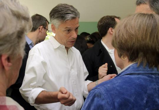 Jon Huntsman talked with guests at a house party in Hancock, N.H., yesterday. The former ambassador spoke about health care, federal spending, and Libya during the day.
