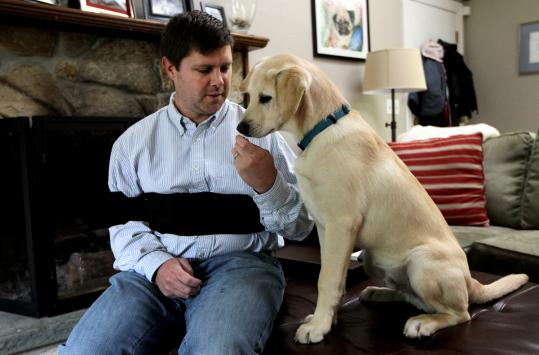 Berkeley O'Keefe with Ziggy, a yellow lab from Arkansas who survived parvovirus.