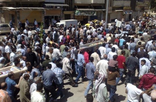 Antigovernment protesters carried the coffins of people who they say were killed in the crackdown in Homs, Syria.