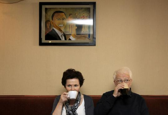 Residents of Moneygall, Ireland, sat beneath a portrait of President Obama in Ollie Hayes's pub.