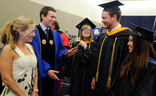 Nicole and Jeff Glor (left) with Katie Arsenault, Andrew Rogers, and Ari Yuen at Suffolk.