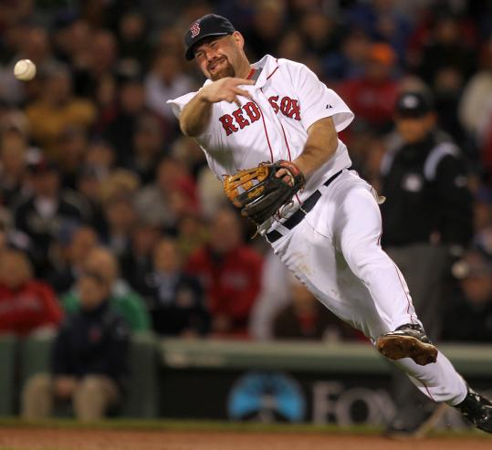 Kevin Youkilis throws out the Cubs' Aramis Ramirez on a topper to third in the fifth inning.