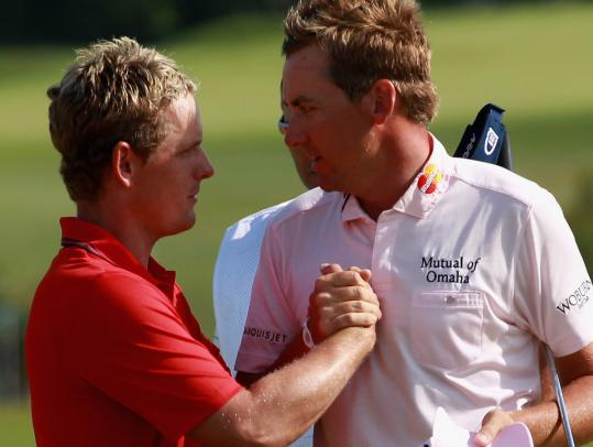 Luke Donald (left) congratulates Ryder Cup teammate Ian Poulter on his 2-and-1 win in the World Match Play final.