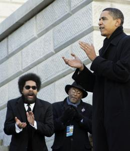 Cornel West, far left, applauds then-Democratic presidential hopeful Barack Obama in 2008.