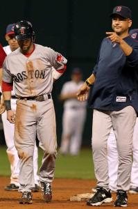 Terry Francona makes the call to remove Dustin Pedroia, who injured his left leg in the eighth inning when he rounded second base and fell awkwardly. Pedroia limped back to the dugout.
