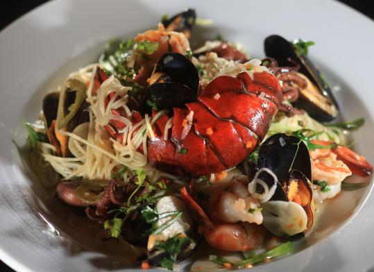 Seafood scampi with lobster tail, shrimp, mussels, and octopus served over angel hair pasta with lemon and garlic butter.