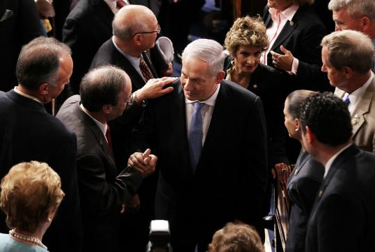 Members of Congress greeted Benjamin Netanyahu yesterday after the Israeli prime minister spelled out his nation's conditions for a compromise with Palestinians. A10.