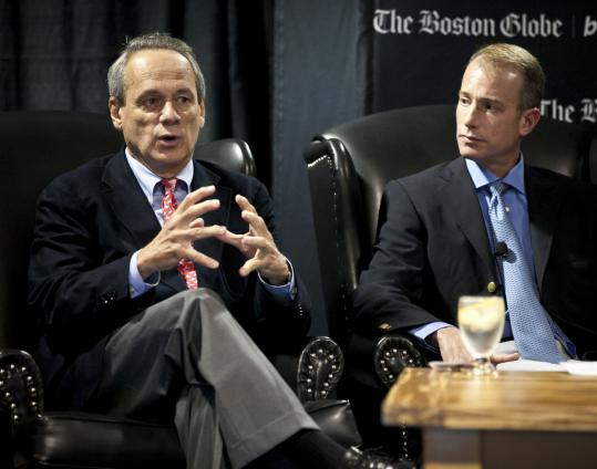 "Red Sox CEO Larry Lucchino (left) and Bruins principal Charlie Jacobs were among the speakers yesterday at a panel discussion on ""The Business of Sports'' at the Hynes Convention Center. Executives focused on such issues as stadium amenities and ticket prices. B9"