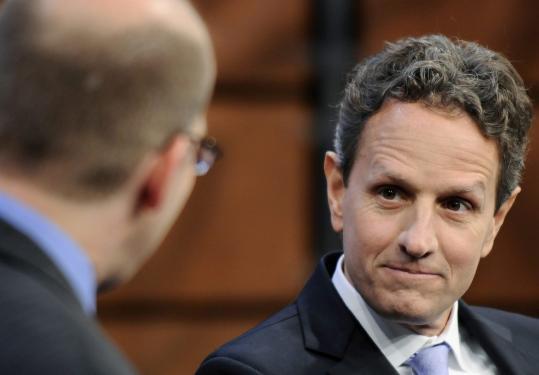 Treasury Secretary Timothy Geithner defended presidential adviser Elizabeth Warren at an event in Washington yesterday.