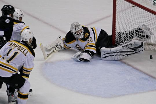 A second-period shot slipped past Bruins goalie Tim Thomas to give the Lightning the lead last night.