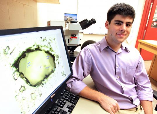 Thomas Weinreich, a junior at Brown University, displayed a photo of lunar soil crystals.