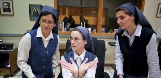 Sister Margaret Timothy Sato, at left in this photo from March, has been replaced as the leader of the Daughters of St. Paul, which has its provincial headquarters in Jamaica Plain.