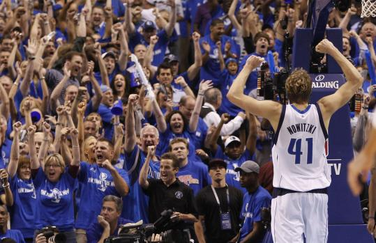 Dirk Nowitzki leads Dallas fans in cheers after the Mavericks won the NBA&#8217;s Western Conference title.