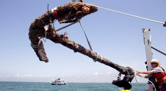 The anchor is 11 feet, 4 inches long with arms 7 feet, 7 inches across, and is estimated to weigh 2,500 to 3,000 pounds.